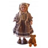 Porzellanpuppe mit Teddybär